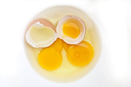 Two raw eggs with egg shell in a white bowl Stock fotó
