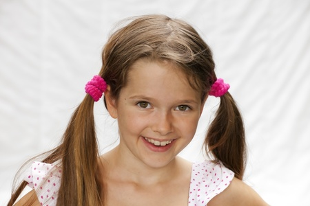 Portrait of a 7 year old girl with a bright background Stock Photo