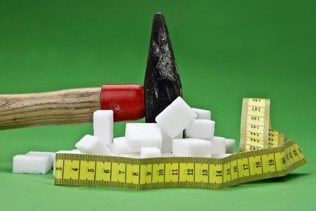a hammer which is disturbing sugar cubes for a healthier nutrition in the future Stock fotó