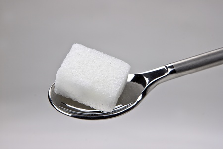 piece of sugar cubes on a spoon Stock Photo
