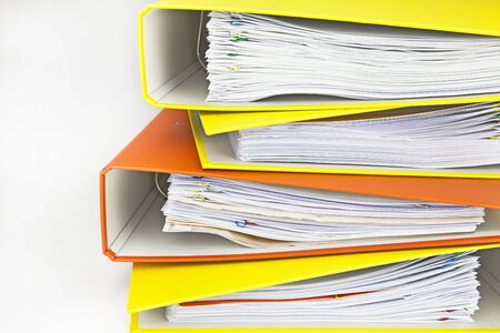yellow and orange file folders stacked on each other Stock Photo