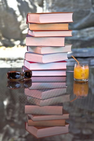 a stack of old books in the sun in summer