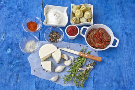 tomato paste: Feta cheese, string cheese, dried tomatoes, artichoke hearts, herbs and tomato paste - the ingredients for a Mediterranean Spreads