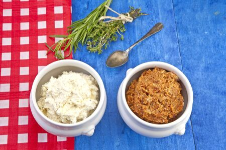 Feta cheese with dried tomatoes and artichoke hearts and spices - ingredients for a Mediterranean Spreads