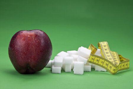 an apple against sugar cubes - healthy versus unhealthy