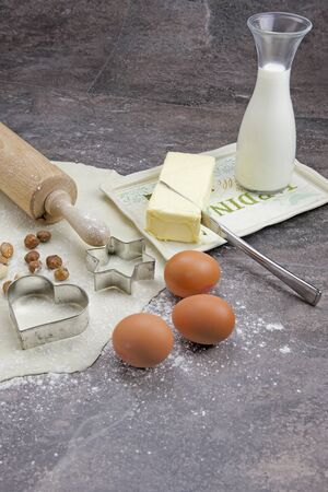 a rolled out dough to bake biscuits with different ingredients photo