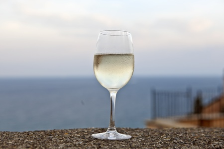 a glass of Prosecco on a wall above Cervo overlooking the Mediterranean