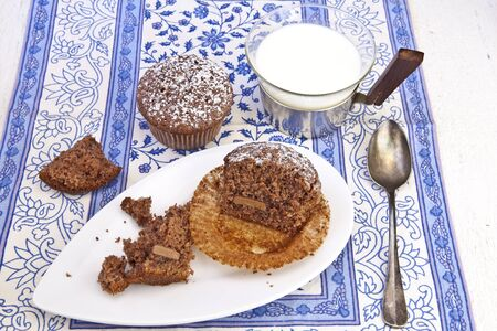 freshly baked chocolate muffins sprinkled with powdered sugar Stock fotó