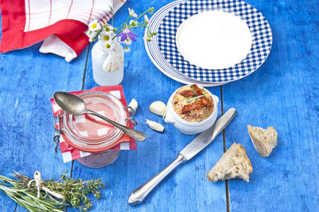 Mediterranean cheese spread made from cream cheese, feta cheese, artichokes and sun-dried tomatoes and herbs photo