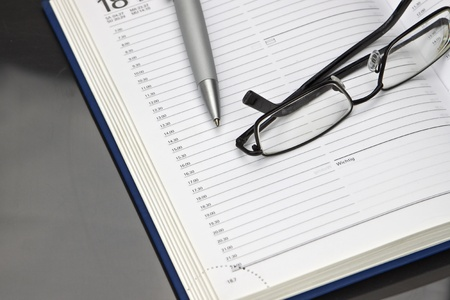 Calendar with pen and glasses