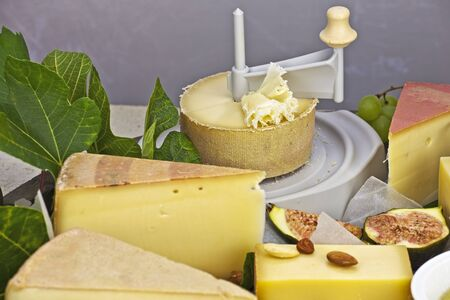 a rich cheese plate, covered as a buffet, consisting of a variety of Swiss cheeses
