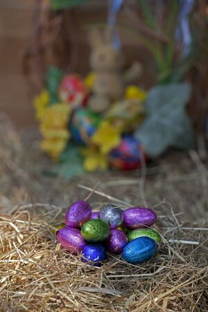colored eggs in a nest of straw