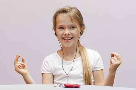 A seven year old girl who used a smartphone Stock Photo - 10032361