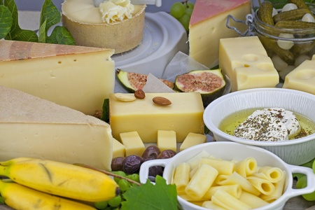 cheese plate: a rich cheese plate, covered as a buffet, consisting of a variety of Swiss cheeses