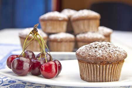 freshly baked chocolate muffins sprinkled with powdered sugar Stock Photo