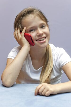 A seven year old girl who used a smartphone Stock Photo - 10097945