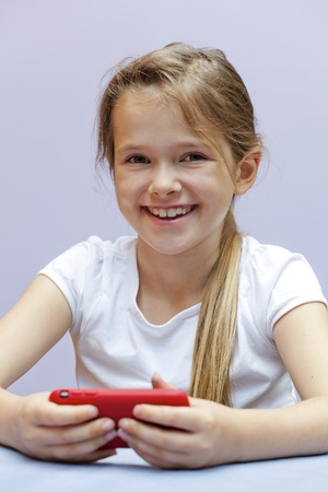 A seven year old girl who used a smartphone Stock Photo - 10097950