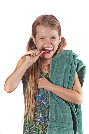 eight year old: eight year old girl with a toothbrush and a towel to clean the teeth