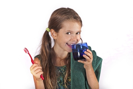 eight year old girl with a toothbrush and a towel to clean the teeth Stock Photo - 10173745