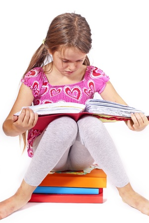 eight year old girl reading a book Stock Photo