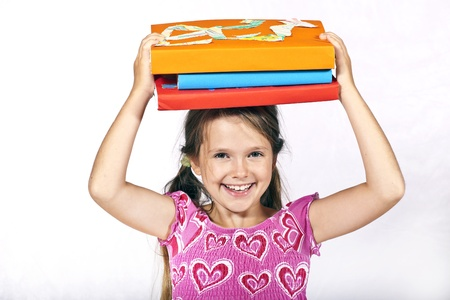 eight year old: eight year old girl has books on the head