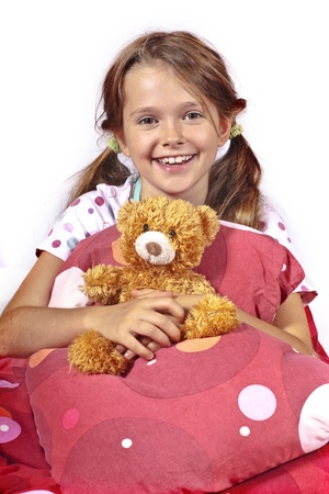 eight year old girl in bed with a teddy bear