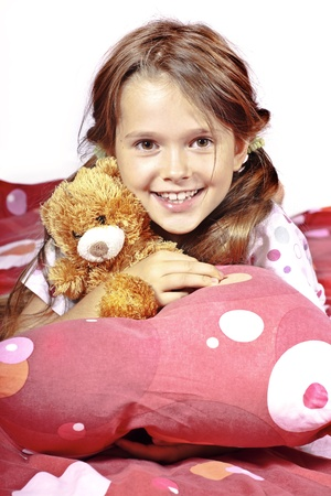 eight year old: eight year old girl in bed with a teddy bear