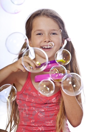 eight year old girl playing with soap bubbles
