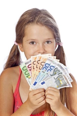 eight year old girl counts her money