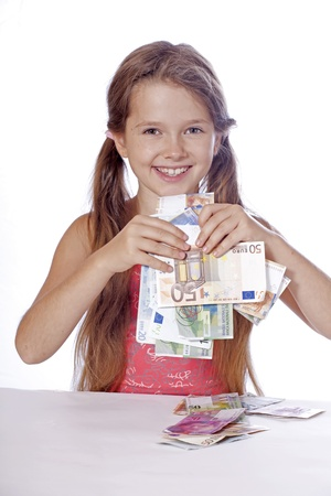 eight year old: eight year old girl counts her money