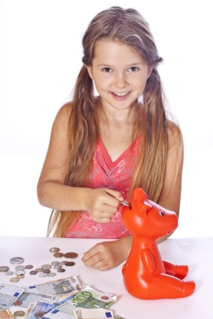 eight year old girl counts her money photo