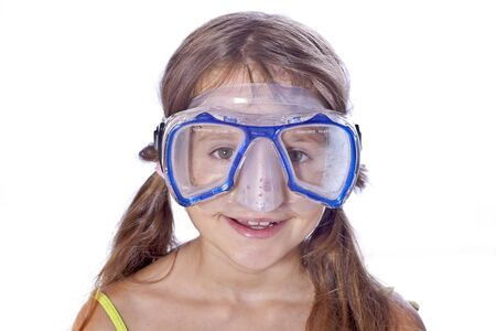eight year old: eight year old girl with diving goggles Stock Photo