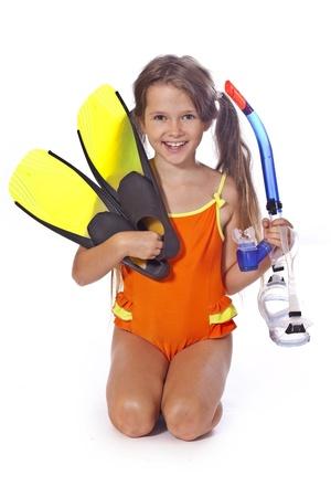 traje de bano: ocho a�os de edad chica con gafas de buceo Foto de archivo