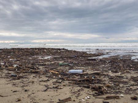 dirty beach - pollution along the beach photo