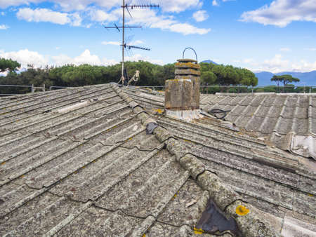 neglect: roof covered with asbestos and concrete panels Stock Photo