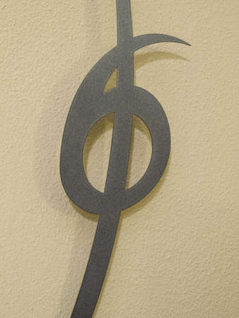 Number six on metal background yellow mustard