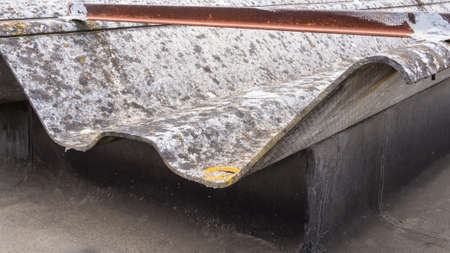 asbestos: roofing sheets containing asbestos abandoned by unknown cause pollution Stock Photo