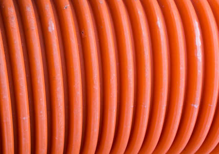 technological: corrugated plastic pipe of orange color for passage of installations technological