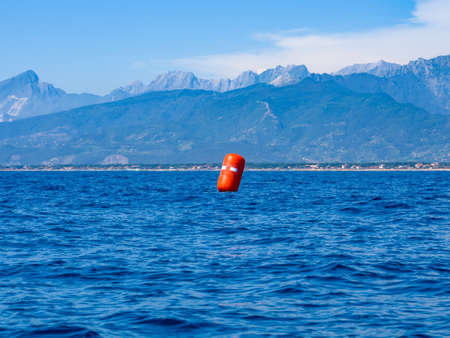 Red buoy upwind ready for the race Stock Photo