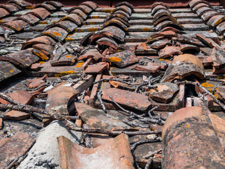 Roof covering in tiles and cladding damaged by a rainstorm and windstorm Archivio Fotografico