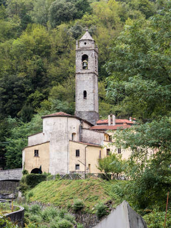 Ancient church with bell tower of a mountainous country of Tuscany Archivio Fotografico