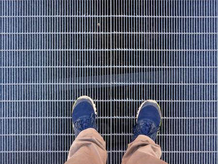 Walking on an iron grate