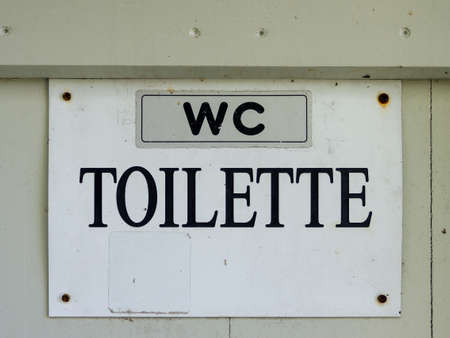 wc toilet - black lettering on a white background Archivio Fotografico