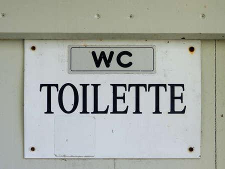 wc toilet - black lettering on a white background Archivio Fotografico - 104855996