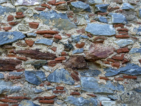 old brick and stone mixed wall Archivio Fotografico - 104855997