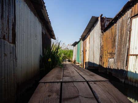 Abandoned iron shacks along the shore of the lake