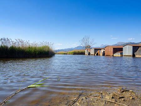 Abandoned iron shacks along the shore of the lake Archivio Fotografico - 104856001