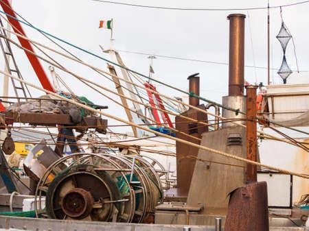 Fishing boats moored at the port quay Archivio Fotografico - 131781404