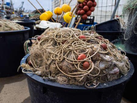 Fishing nets along the port quay Archivio Fotografico