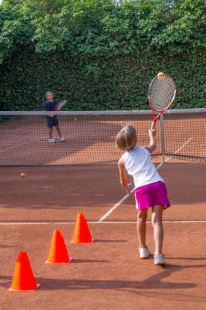 children to tennis school photo
